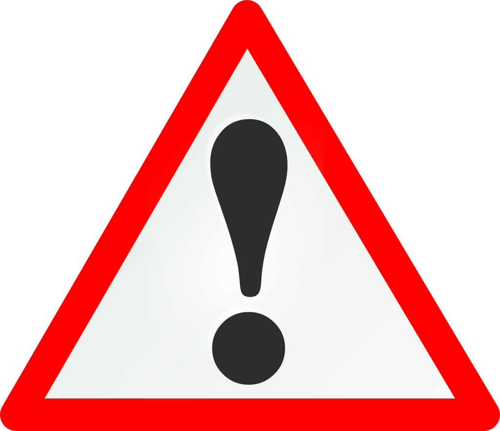 Grafika przedstawiająca znak ostrzegawczy.